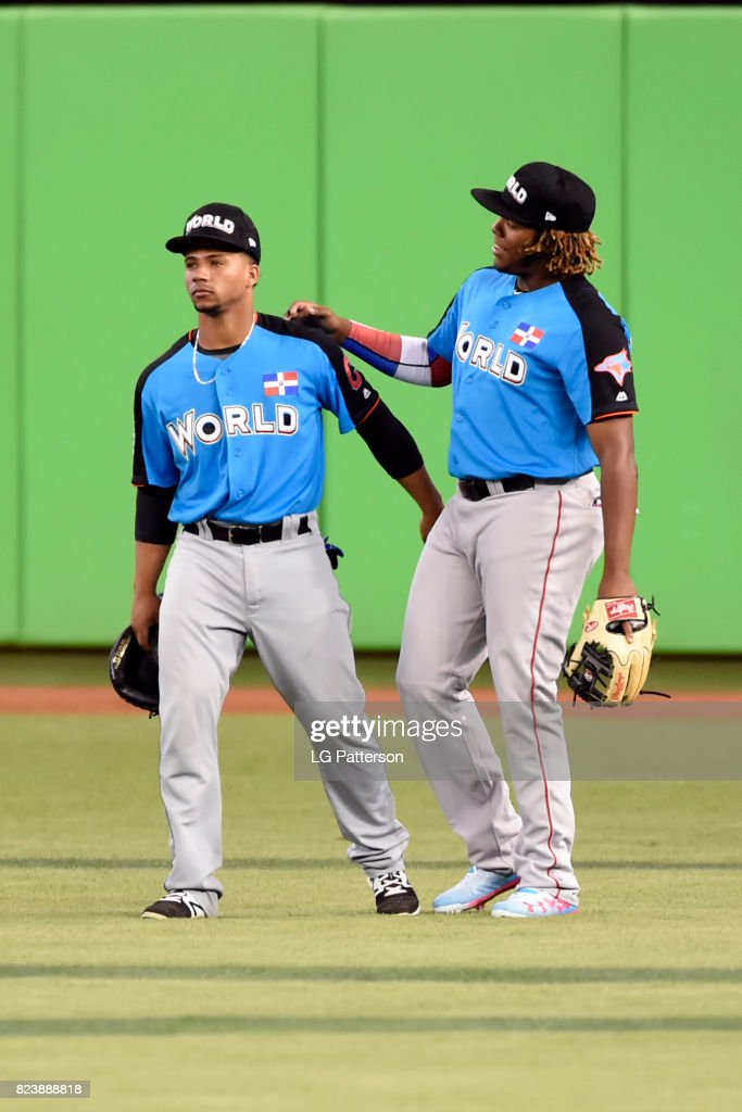 Francisco Meija #17 and Vladimir Guerrero Jr. #27 of the World Team joke around during batting practice prior to the SirusXM All-Star Futures Game at Marlins Park on Sunday, July 9, 2017 in Miami, Florida.