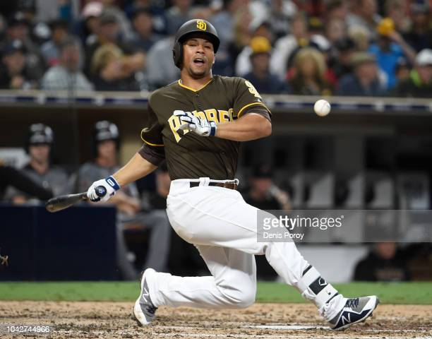 Francisco Mejia of the San Diego Padres falls as he swings for a pitch during the sixth inning of a baseball game against the Arizona Diamondbacks at...