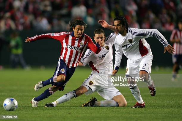 Francisco Mendoza of CD Chivas USA makes a move around Kenny Deuchar and Matias Mantilla of Real Salt Lake in the second half during their MLS game...