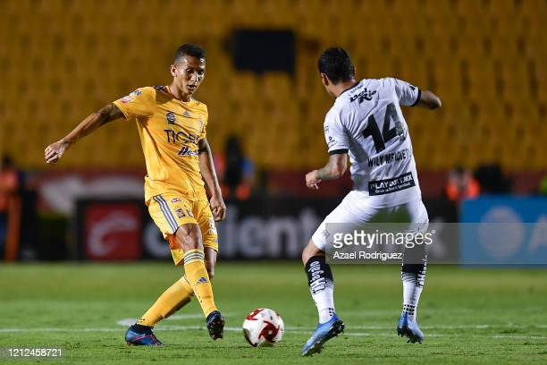 Francisco Meza of Tigres fights for the ball with William Mendieta of Juárez during the 10th round match between Tigres UANL and FC Juarez as part of...