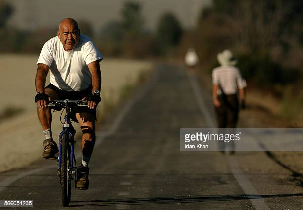 Francisco Mora rides his bike along the San Gabriel river in east side of Whittier Narrows Nature Area in South El Monte