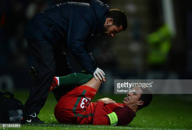 Francisco Morais Saldanha of Portugal 17s goes down injured during the International Match between England U17 and Portugal U17 at Proact Stadium on...
