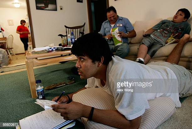 Francisco Paco Inzunza's older son Paco Jr a senior who has been taking honors classes at the Marshall High School studies on the floor as his dad...