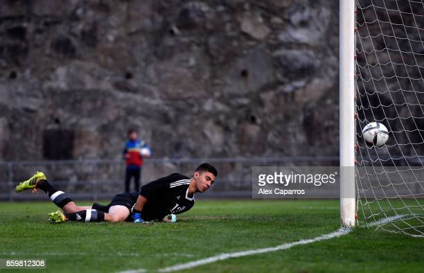Francisco Pires of Andorra can't save a shot from Tom Davies of England as he scores the 1st goal during the UEFA European Under 21 Championship...