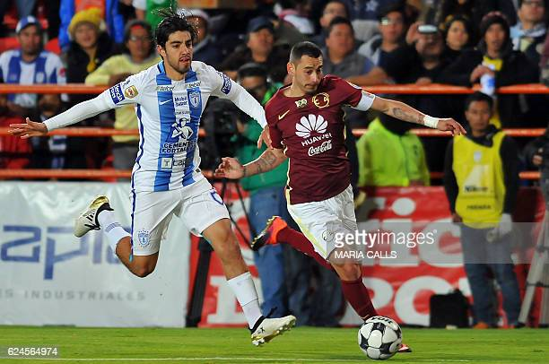 Francisco Pizarro of Pachuca vies for the ball with Rubens Sambueza of America during their Mexican Apertura 2016 Tournament football match at...