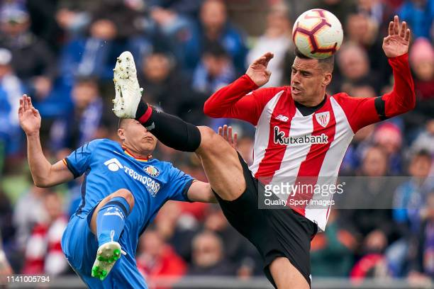Francisco Portillo of Getafe CF battle for the ball with Dani Garcia of Athletic Club during the La Liga match between Getafe CF and Athletic Club at...