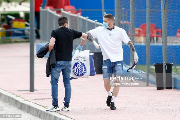 Francisco Portillo of Getafe saludates to Vitorino Antunes arrives to take a medical test at Ciudad Deportiva Getafe to check the state of their...