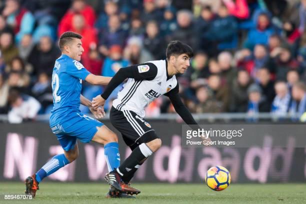 Francisco Portillo Soler of Getafe CF in action against Carlos Soler Barragan of Valencia CF during the La Liga 201718 match between Getafe CF and...