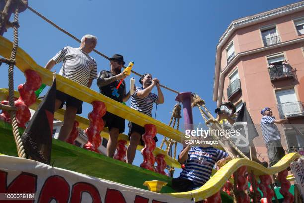 Francisco Pérez Ramos and Cesar Strawberry with the Cofradia Naval Vallecana are seen during the event. Thousands of people gathered on the street to...