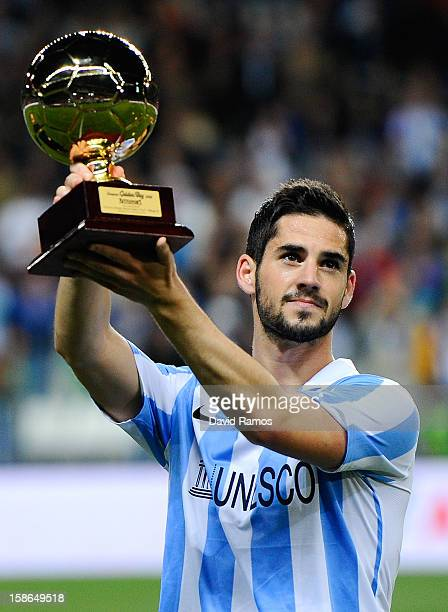 Francisco R Alarcon Isco of Malaga CF holds up the 'Golen boy' trophy for being the best U21 European player given by the sports daily newspaper...
