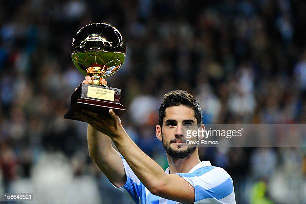Francisco R. Alarcon Isco of Malaga CF holds up the 'Golen boy' trophy for being the best U-21 European player given by the sports daily newspaper...
