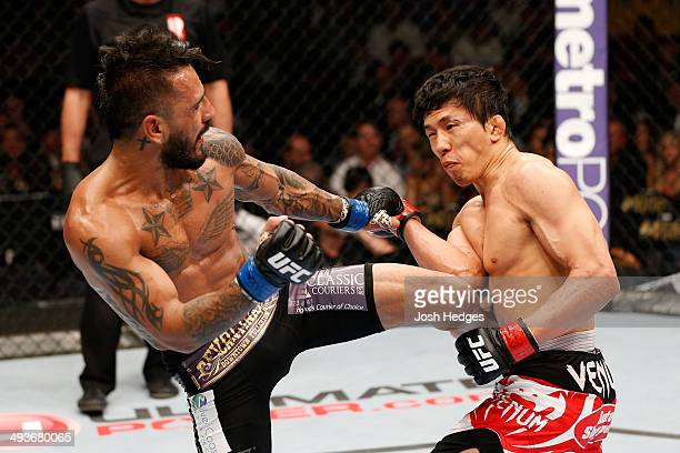 Francisco Rivera kicks Takeya Mizugaki in their bantamweight bout during the UFC 173 event at the MGM Grand Garden Arena on May 24, 2014 in Las...