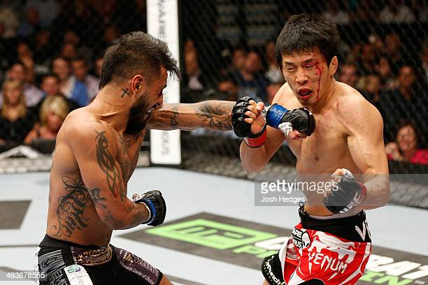 Francisco Rivera punches Takeya Mizugaki in their bantamweight bout during the UFC 173 event at the MGM Grand Garden Arena on May 24 2014 in Las...