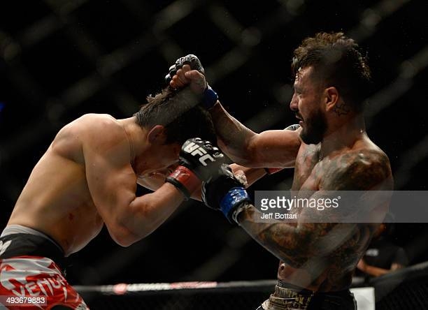 Francisco Rivera punchess Takeya Mizugaki in their bantamweight bout during the UFC 173 event at the MGM Grand Garden Arena on May 24, 2014 in Las...