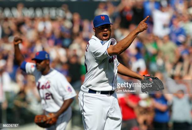 Francisco Rodriguez and Carlos Delgado of the New York Mets celebrates after the final out against the Milwaukee Brewers on April 18 2009 at Citi...