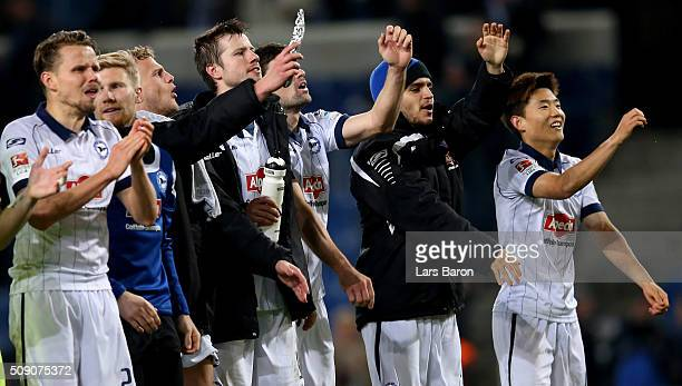 Francisco Rodriguez of Bielefeld and Seung Woo Ryu celebrate with team mates after winning the Second Bundesliga match between Arminia Bielefeld and...