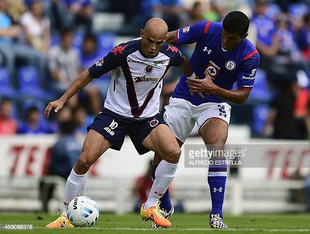 Francisco Rodriguez of Cruz Azul vies for the ball with Carlos Ochoa of Veracruz during their Apertura 2014 Mexican tournament football match at the...