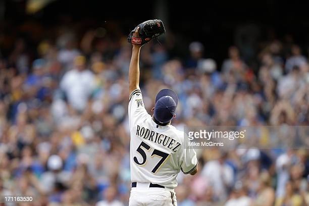 Francisco Rodriguez of the Milwaukee Brewers celebrates after getting his 300th career save in the 20 victory over the Atlanta Braves during the game...