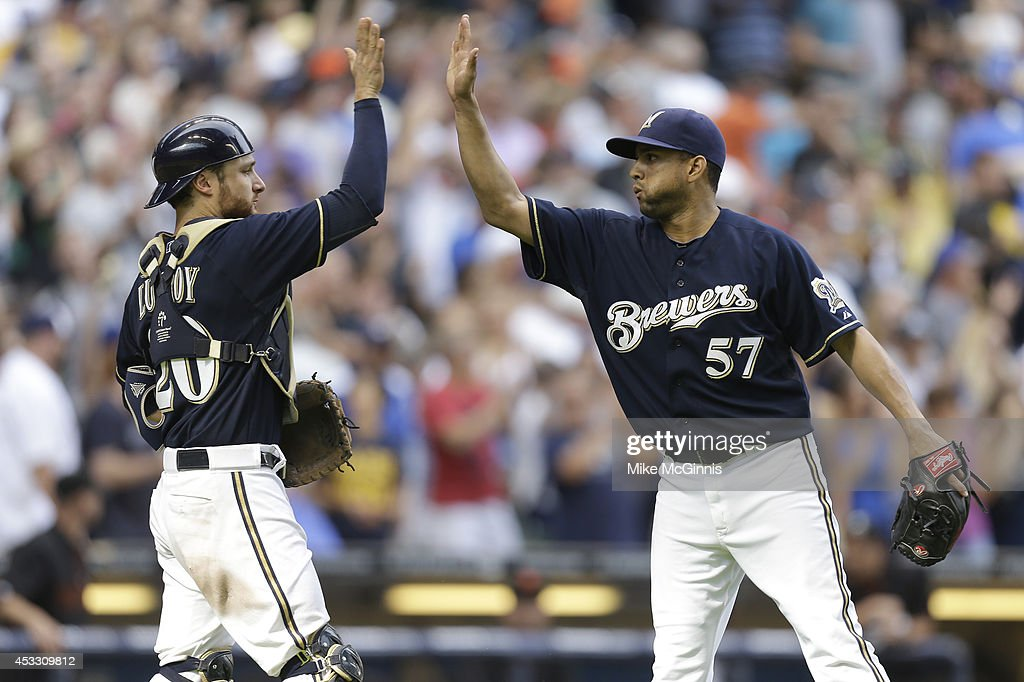 Francisco Rodriguez #57 of the Milwaukee Brewers celebrates with Jonathan Lucroy #20 after the 3-1 win over the San Francisco Giants at Miller Park on August 07, 2014 in Milwaukee, Wisconsin.