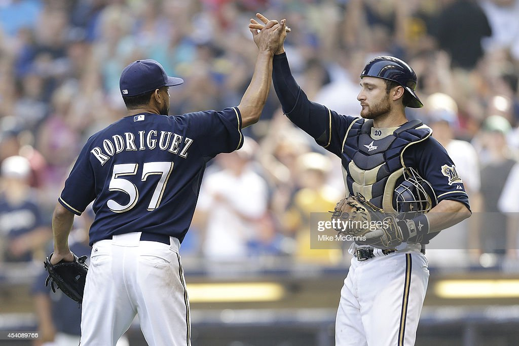 Francisco Rodriguez #57 of the Milwaukee Brewers celebrates with Jonathan Lucroy after the 4-3 win over the Pittsburgh Pirates at Miller Park on August 24, 2014 in Milwaukee, Wisconsin.