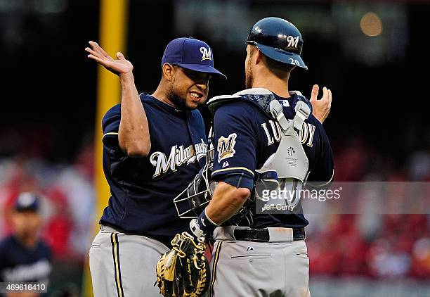 Francisco Rodriguez of the Milwaukee Brewers celebrates with Jonathan Lucroy after closing out the ninth inning and defeating the St Louis Cardinals...
