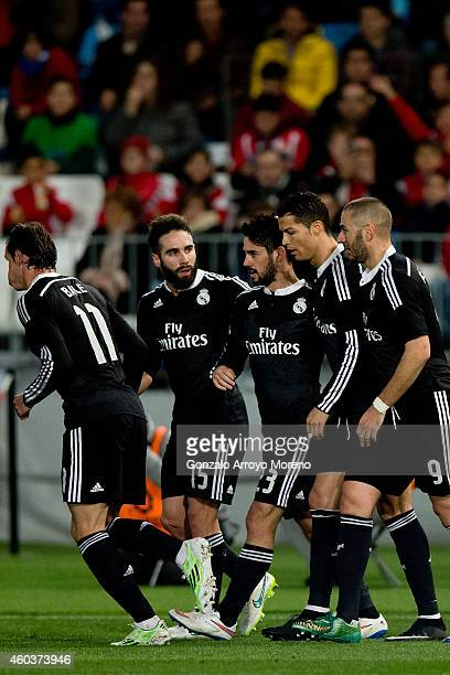 Francisco Roman Alarcon alias Isco of Real Madrid CF celebrates scoring their opening goal with teammates during the La Liga match between UD Almeria...