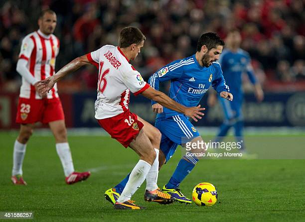 Francisco Roman Alarcon alias Isco of Real Madrid CF competes for the ball with Sebastian Dubarbier of Almeria UD during the La Liga match between UD...