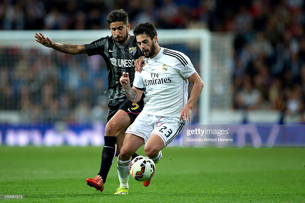 Francisco Roman Alarcon alias Isco (R) of Real Madrid CF competes for the ball with Samuel Garcia Snachez (L) of Malaga CF during the La Liga match between Real Madrid CF and Malaga CF at Estadio Santiago Bernabeu on April 18, 2015 in Madrid, Spain.