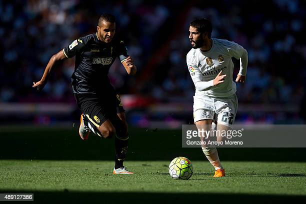 Francisco Roman Alarcon alias Isco of Real Madrid CF competes for the ball with Youssef ElArabi of Granada CF during the La Liga match between Real...