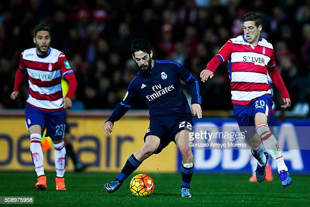 Francisco Roman Alarcon alias Isco of Real Madrid CF competes for the ball with Ruben Perez of Granada CF and his teammate Ruben Rochina during the...