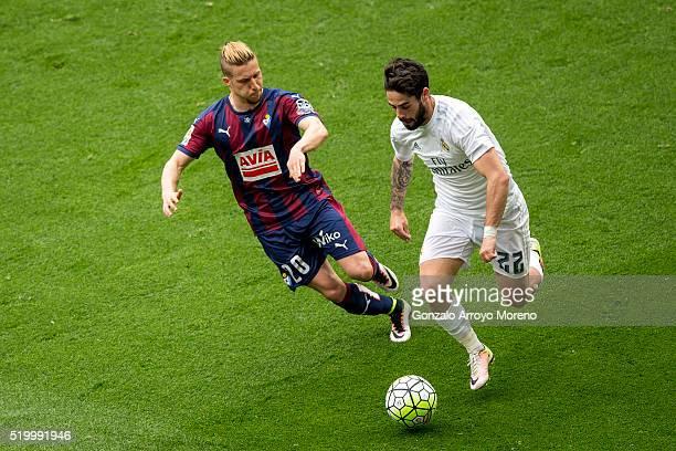 Francisco Roman Alarcon alias Isco of Real Madrid CF competes for the ball with Sergio Gontan alias Keko of SD Eibar during the La Liga match between...