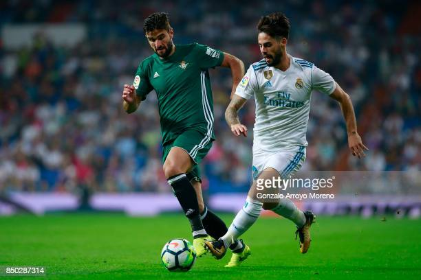 Francisco Roman Alarcon alias Isco of Real Madrid CF competes for the ball with Antonio Barragan of Real Betis Balompie during the La Liga match...