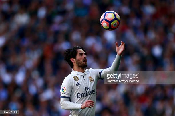 Francisco Roman Alarcon alias Isco of Real Madrid CF takes the ball for a kickoff during the La Liga match between Real Madrid CF and Deportivo...