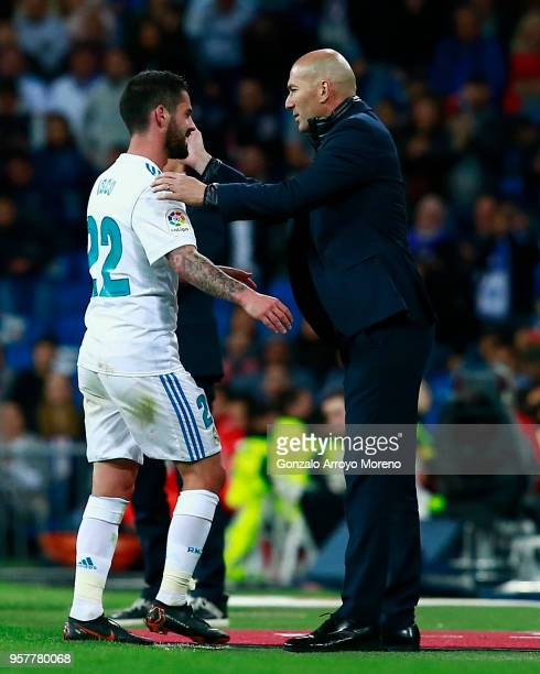 Francisco Roman Alarcon alias Iscod of Real Madrid CF is greeted by his coach Zinedine Zidane as he leaves the pitch during the La Liga match between...