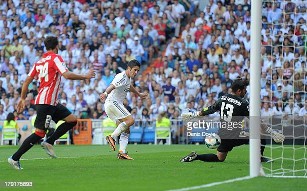 Francisco Roman 'Isco' of Real Madrid shoots past Iago Herrerin of Athletic Club Bilbao to score Real's opening goal during the La Liga match between...