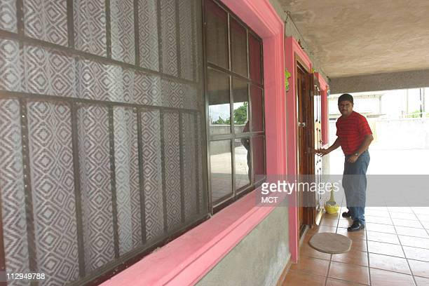 Francisco Ruiz uses the wall to steady himself as he moves around his home near Tampico Mexico He was hurt while working construction near Charlotte...