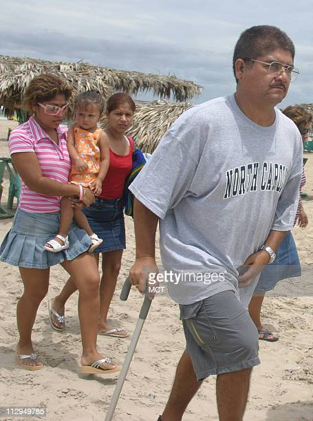 Francisco Ruiz walks on the beach in Tampico Mexico with his two daughters and grandchild years after suffering a workrelated in the United States...