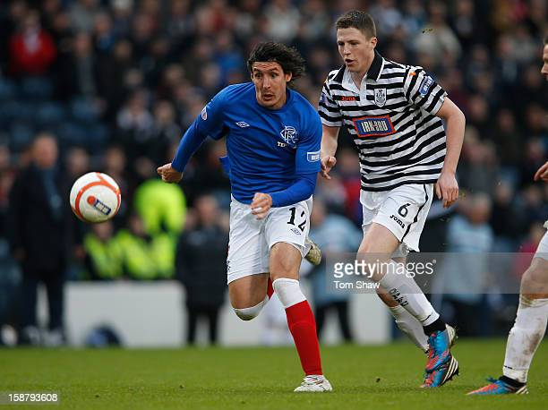 Francisco Sandaza of Rangers tussles with Paul Gallacher of Queens Park during the IRNBRU Scottish Third Division match between Queens Park and...