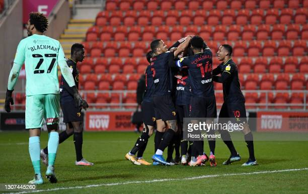 Francisco Sierralta of Watford celebrates with team mates after scoring their side's first goal during the Sky Bet Championship match between...