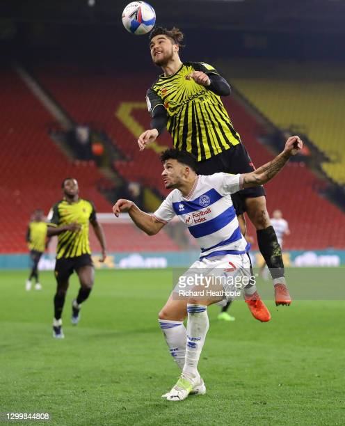 Francisco Sierralta of Watford FC battles for possession with Macauley Bonne of Queens Park Rangers in the air during the Sky Bet Championship match...