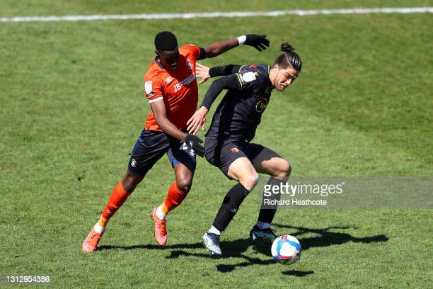 Francisco Sierralta of Watford FC battles for possession with Elijah Adebayo of Luton Town during the Sky Bet Championship match between Luton Town...