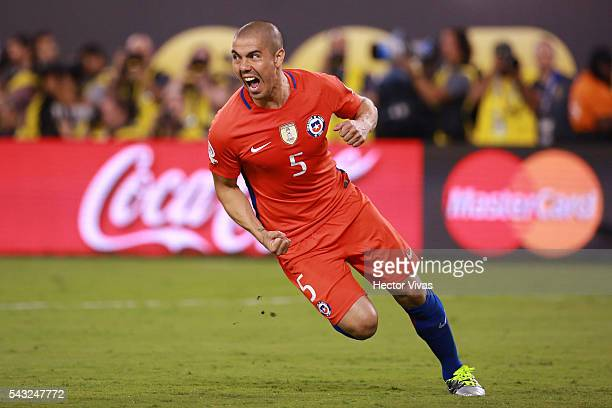 Francisco Silva of Chile celebrates after scoring the last penalty during the championship match between Argentina and Chile at MetLife Stadium as...