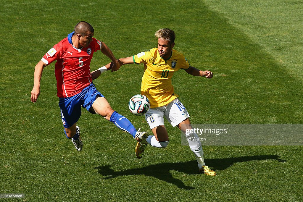 Francisco Silva of Chile challenges Neymar of Brazil during the 2014 FIFA World Cup Brazil round of 16 match between Brazil and Chile at Estadio Mineirao on June 28, 2014 in Belo Horizonte, Brazil.
