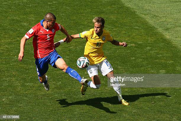 Francisco Silva of Chile challenges Neymar of Brazil during the 2014 FIFA World Cup Brazil round of 16 match between Brazil and Chile at Estadio...