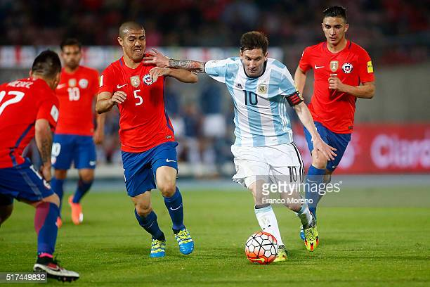 Francisco Silva of Chile fights for the ball with Lionel Messi of Argentina during a match between Chile and Argentina as part of FIFA 2018 World Cup...