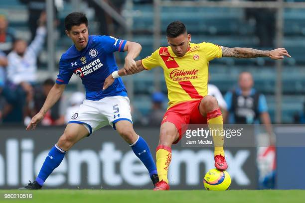 Francisco Silva of Cruz Azul and Sebastian Vegas of Morelia fight for the ball during the 16th round match between Cruz Azul and Morelia at Azul...