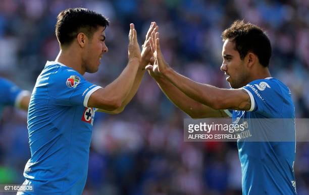 Francisco Silva of Cruz Azul celebrates his goal against Guadalajara with his teammate Enzo Pablo Roco during their Mexican Clausura 2017 tournament...