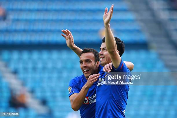 Francisco Silva of Cruz Azul celebrates his team's first goal with teammate Omar Mendoza during the 15th round match between Cruz Azul and Tigres...