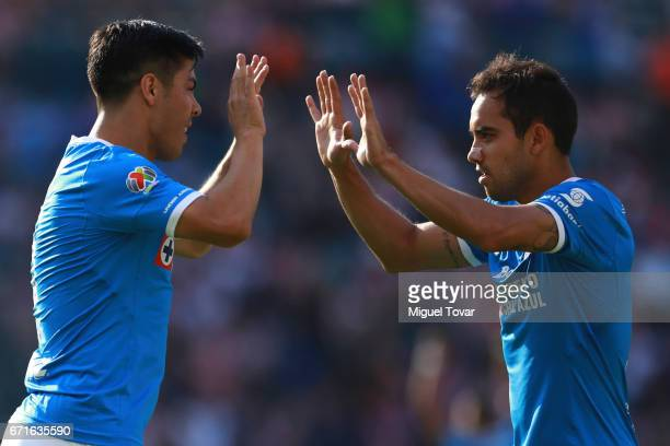 Francisco Silva of Cruz Azul celebrates with teammate Adrian Aldrete after scoring his team's first goal during the 15th round match between Cruz...