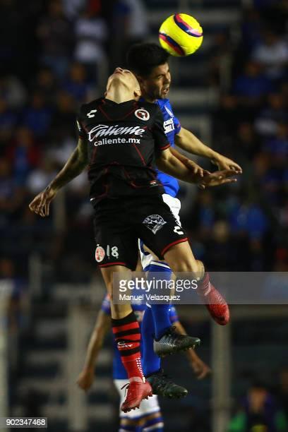 Francisco Silva of Cruz Azul struggle for the ball against Juan Iturbide of Tijuana during the first round match between Cruz Azul and Tijuana as...